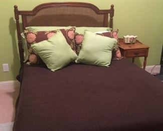 $645 - Ballard Designs queen mahogany/cane headboard, frame and mattress set. Linens priced separately ($175).