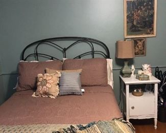 . . . a nice full wrought-iron headboard/bed