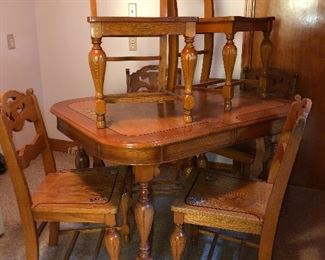 Lot #17 Kitchen table (2 leaves stored under table) with 6 sturdy chairs, $200