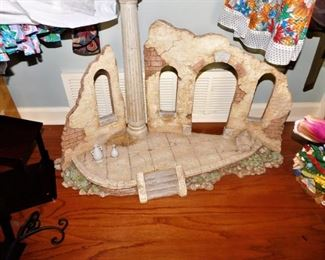 Very interesting piece. appears to be a Roman ruin piece, hand made, for decor of your choosing. Cool! Not small!