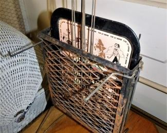 This is also interesting. This is a cheap metal tray with nice graphics. Includes 4 rotissory wire handled frames for cooking over a fire. The whole set is intact and complete. Cool!
