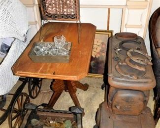 The iron stove on the right is solid; not sure of how many pieces. The horseshoes are authentic. The iron fire-pit is exceptional; I am not sure of the different color stones.