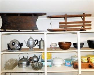 I believe those are infant sleds on the top shelf. Both are antique.