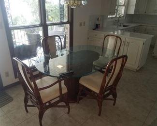 Nice rattan / glass top kitchen table.