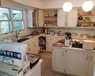 Kitchen is overflowing with quality cookware and utensils.