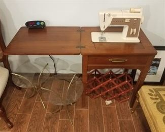 Singer hide a way sewing machine.Two glass & brass side tables.