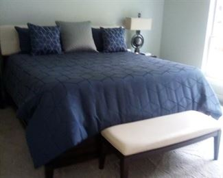 King size bedroom, bench, linens, mattress