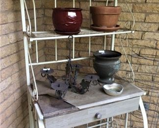 This baker's rack could serve as a great potting table.
