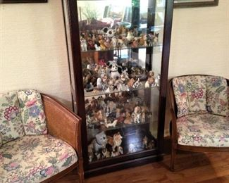Curio cabinet of miniature dogs; matching cane side chairs