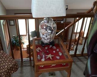 Vitrine / Curio like side table , and lamp. Sea shells