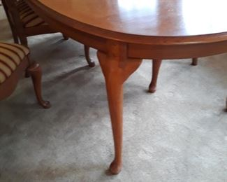"""An oval table that has two 20"""" leaves."""