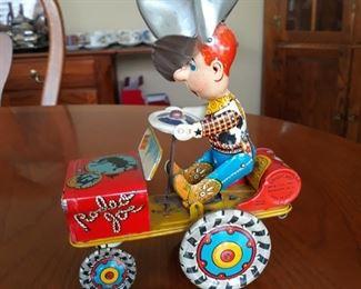 Vintage wind up tin toy