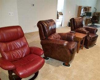 2 matching brown leather recliners and 2 matching burgundy leather recliners with footrests