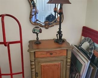 Foyer table, mirror, lamp and wall art
