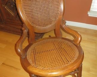 $75% off now $25 $100 Antique American Walnut Cained Rocking Chair
