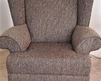 Beautiful brown tweed wing chair.