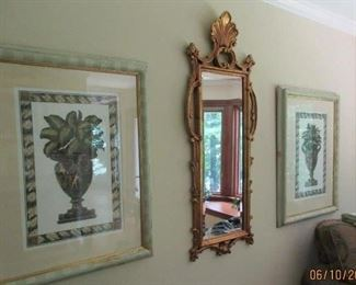 prints and gold mirror