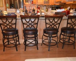 set of four bar stools - adjusts to counter or bar heights