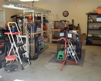 Organized garage full of well maintained tools, shelving, gardening items