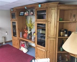 . . . this wall unit is spectacular and features plenty of nooks and cabinets to display your treasures
