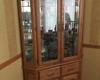 . . . a beautiful oak corner cabinet
