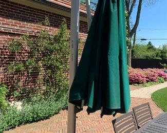 Sola large umbrella. Measures 9' tall. Base measures 4' in diameter.  $100