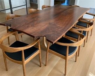 """Alternate view - Solid walnut live edge slab dining table with solid cast bronze base legs by Jeffrey Greene. MEASUREMENTS:  31""""H x 94 1/2""""L x 48 1/2""""D.   $1850."""