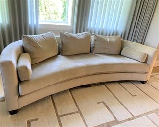 """Curved Interior Crafts sofa with down filled cushions. MEASUREMENTS:  27 1/2""""H x 96""""L x 42""""D.   $1200."""