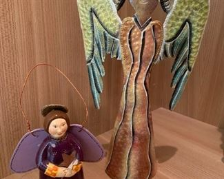 """Pair of angel figurines.  MEASUREMENTS:  12""""H x 7""""W. Smaller piece 5 1/4""""H.  $25"""