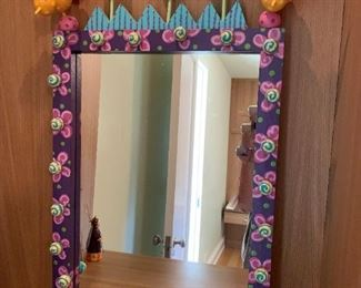 """Artisan crafted birds and flowers mirror.  MEASUREMENTS:  30""""H x 21""""W.   $75"""