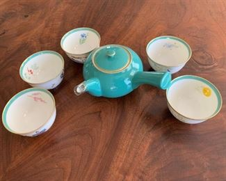 """Fine porcelain teapot and cups.  MEASUREMENTS:  Teapot - 7"""" wide from handle. Cups 2 1/4""""H x 3 1/2""""D.  $35"""