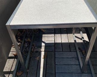 """Pair of chrome and granite side tables.  MEASUREMENTS:  19""""H x 19"""" x 19"""".  $225"""