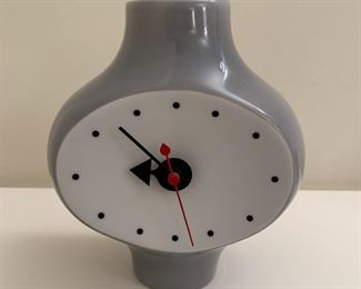 "George Nelson Vitra ceramic clock.  MEASUREMENTS:  7""H x 6""W x 3 1/2""D.  $175"