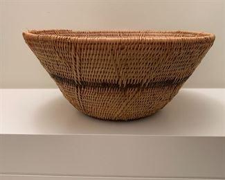 """Hand woven basket.  MEASUREMENTS:  5""""H x 11""""D.  $35"""