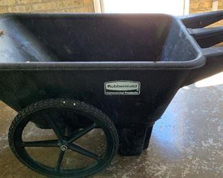 "Large Rubbermaid wheel barrow.  MEASUREMENTS:  28""H x 57""L x 28""W. Bucket measures 28""W x 44""L x 15""D.  $75"