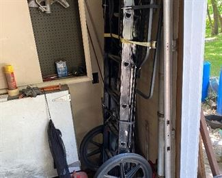 Deer stand/carrier, plastic gas cans, pipe bender head