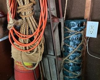 Rope, extension cords, rubber fencing, vintage metal and wood sled