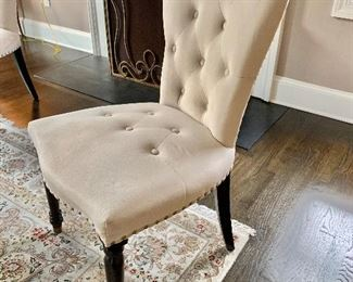 "Upholstered tufted dining chairs.  Eight available.  40.5""H x 21""D x 23""W"