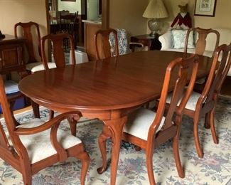 Henkel Harris mahogany dining table with eight chairs. two leaves & pads.