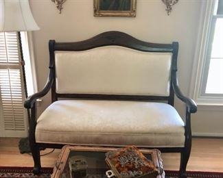 Solid wood settee with clean white upholstery