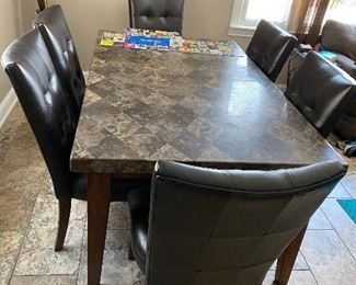 Solid marble top table (chairs are sold)