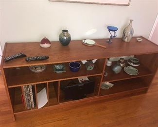 NICE COLLECTION OF SIGNED POTTERY PIECES THIS LONG TABLE BOOKSHELF IS SOLD