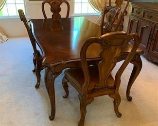 Bernhardt Dining Table w/6 Leather Seated Chairs and 2 additional Leaves and Pads $1,800.00