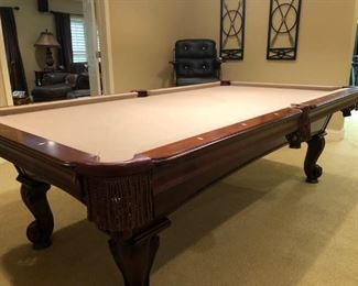 $2,200 - Olshausen regulation mahogany billiards table;  leather pockets; heavily carved feet; comes with accessories and cue rack; Accu-Fast; 30th anniversary edition; manufacturer in the USA.