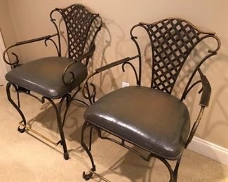 $170 EACH - Pair wrought iron bar chairs with leather seating.