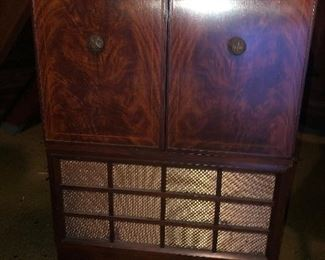 Lot 15B Vintage General Electric Console TV, This TV is located up a very steep set of stairs and needs to be moved out by purchaser. $200