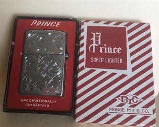 Lot 75B, Vintage Prince lighter in box, $14