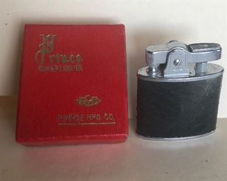Lot 77B, Vintage Prince lighter in box, $14