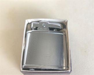 Lot 80B, Vintage Elite lighter in box, $12
