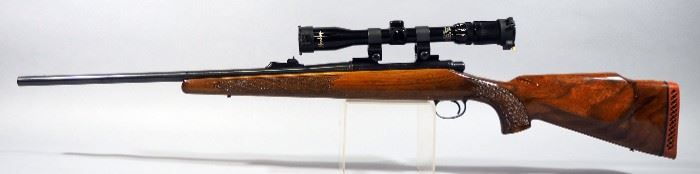 Remington Model 700 .243 WIN Bolt Action Rifle SN# 6231397, With Mossberg 3-9x32 Scope